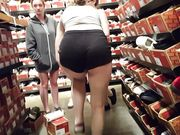 Pale thick teen beauty in tight shorts shopping mall