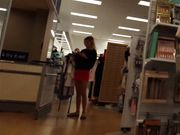 Candid voyeur blonde amateur in tight red skirt shoppin