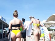Two hot girls in small bikini from behind