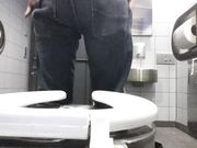 Boy change his diaper in a Bus Station toilet