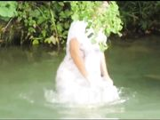 Grannys in Wet See-Through Clothes at Public Baptism