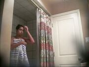 Young Woman Takes A Shower.